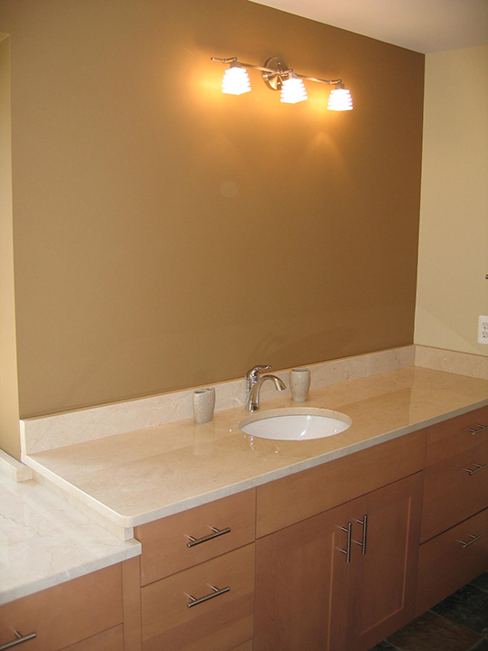 Bathroom with marble counter tops and marble back splash