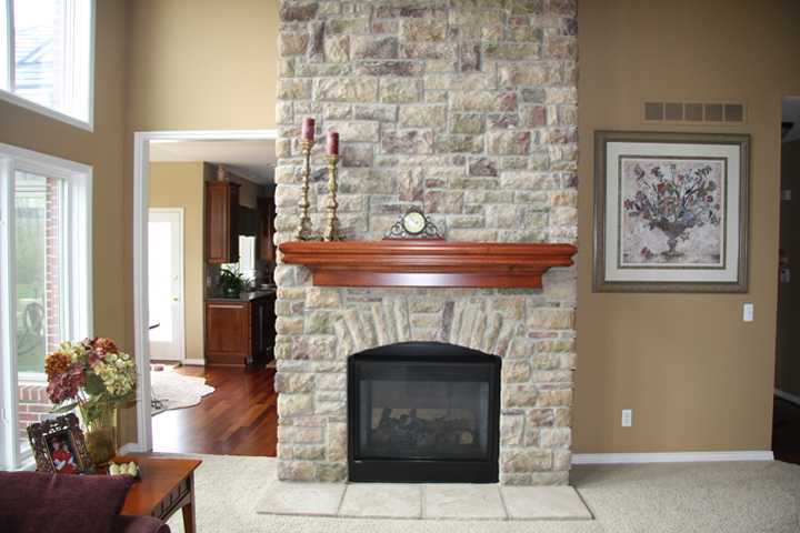 Brick fireplace with wooden mantel