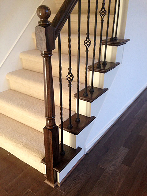 Carpeted staircase with oak end caps