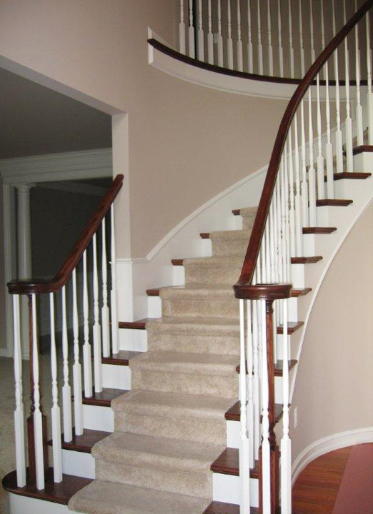 Curved Staircase with painted spindles and vuelet