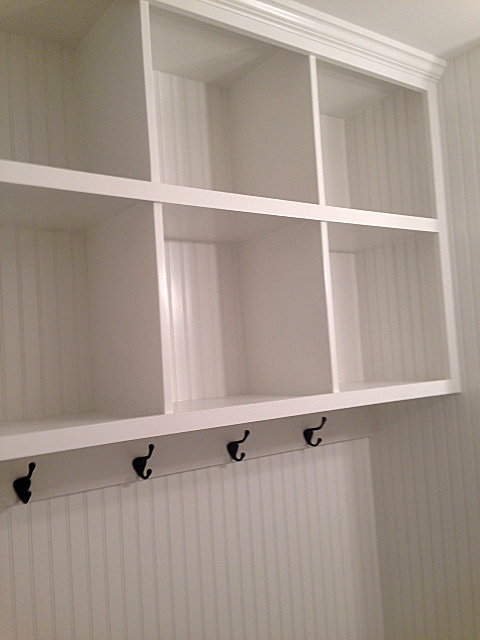 Custom built in shelves with wainscoting paneling