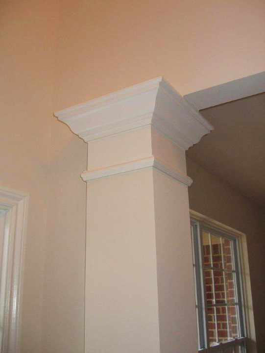 Decorative column with crown molding