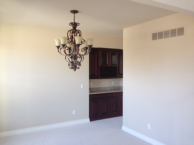 Dining room with adjacent dry bar
