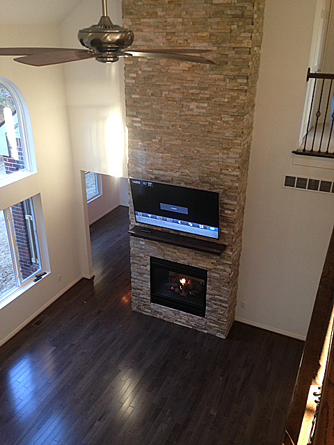 Fireplace built into stacked ledge rock from floor to ceiling