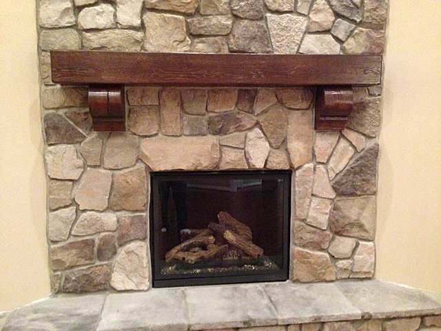 Fireplace with custom timber mantel