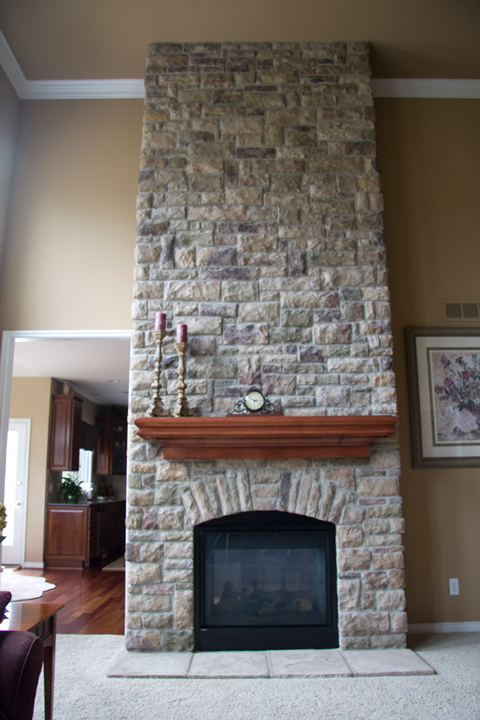 Fireplace with external brick from ceiling to floor