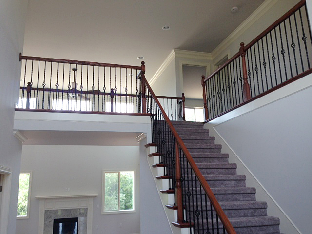 Foyer portion of split staircase, view from foyer