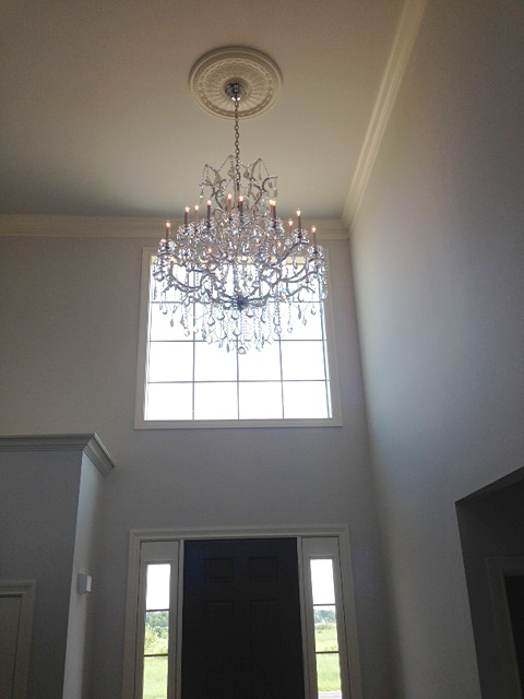 Foyer with open ceilings and chandelier
