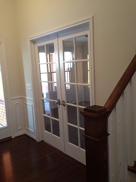 Foyer with ten light double doors entrance into next room