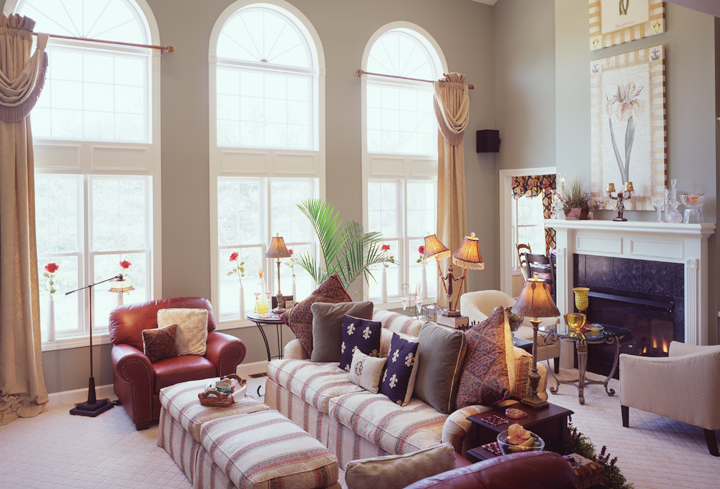 Great room featuring fireplace and two-story windows