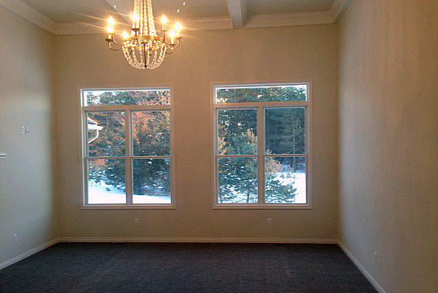 Great room with crown molding and seven light chandelier