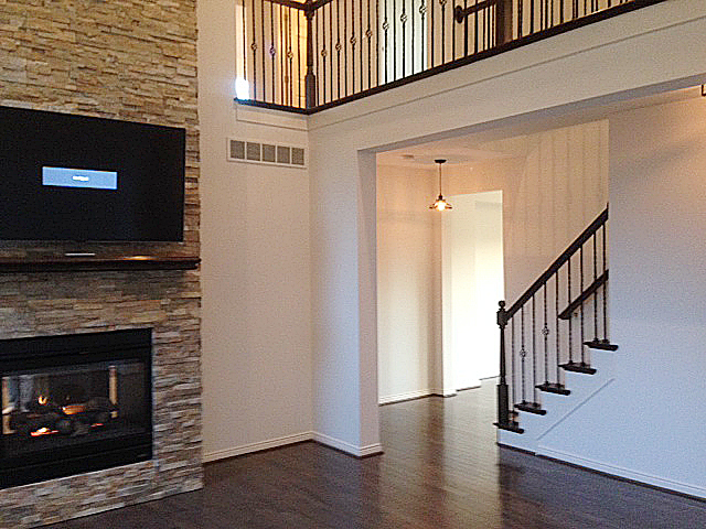 Great room with fireplace encased in stacked ledge rock