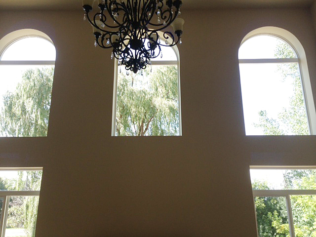Great room with two-story ceilings and decorative chandelier