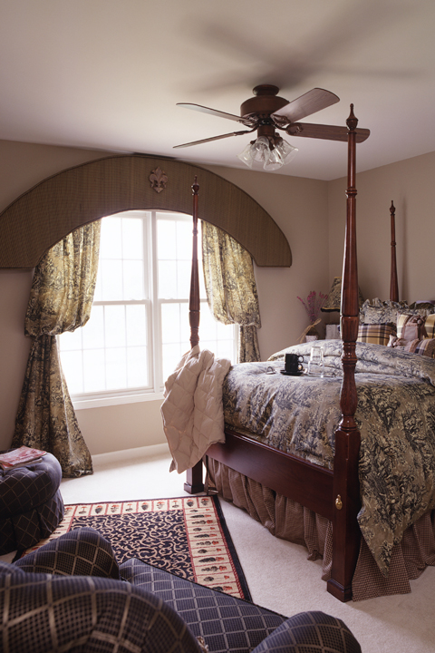 Guest bedroom with paneled windows
