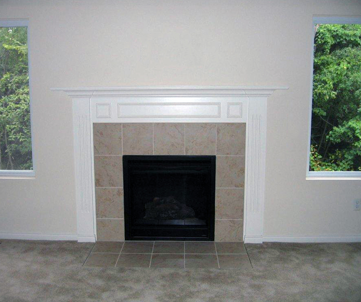 Interior fireplace with white painted mantel