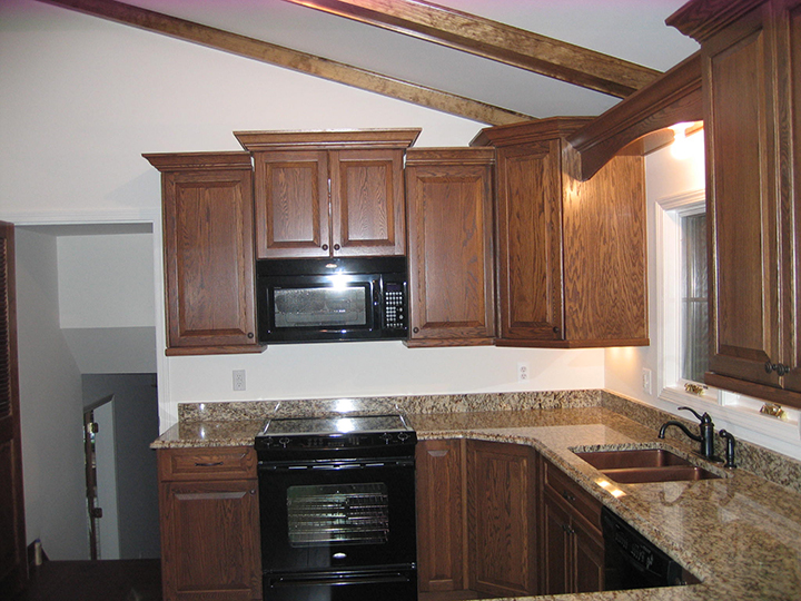 Kitchen featuring a ceiling with accent columns