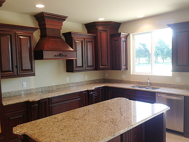 Kitchen featuring a wooden hood vent and island with turtles