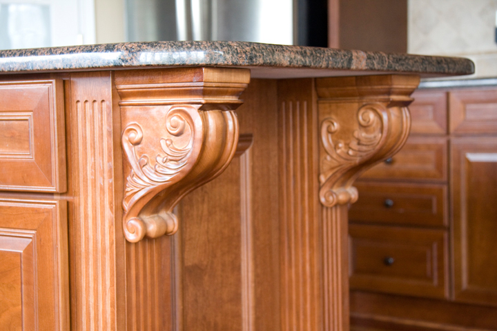 Kitchen island with corbels supporting granite overhang