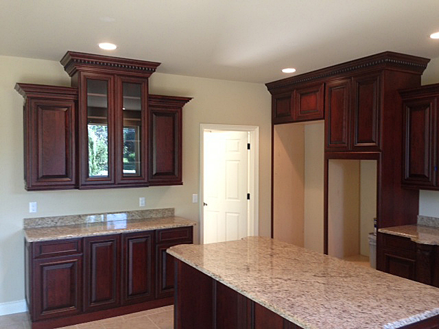 Kitchen with cabinetry featuring crown molding at top