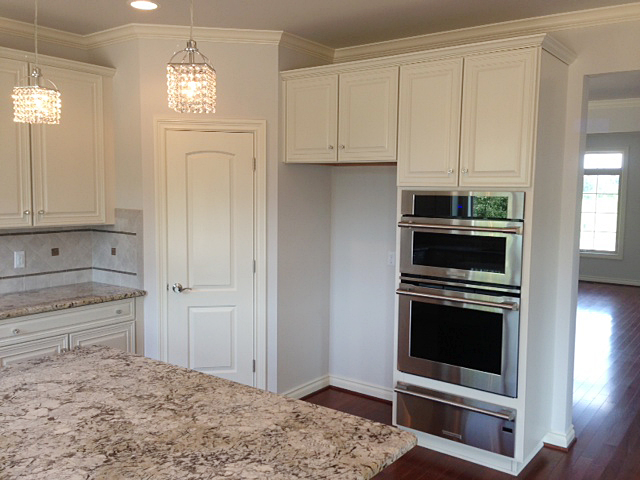 Kitchen with centrally located pantry