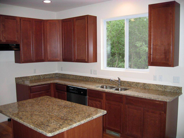 kitchen with granite counter tops and island featuring snack bar