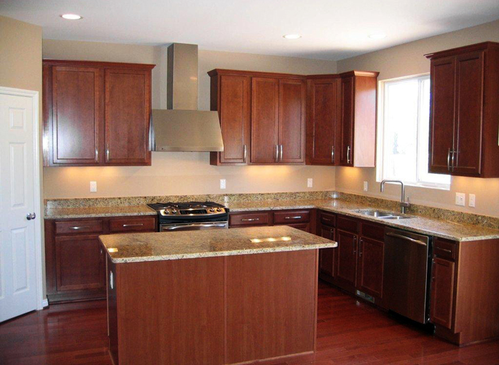 Kitchen with granite counter tops, cherry finish cabinets, and island with snack bar