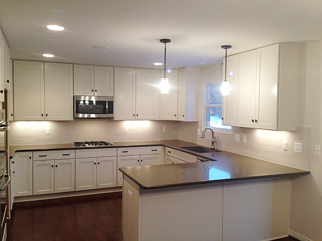 Kitchen with quartz counter tops and white painted shaker cupboards