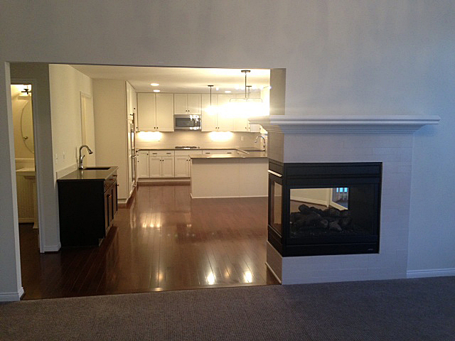 Kitchen with three sided fireplace and wet bar