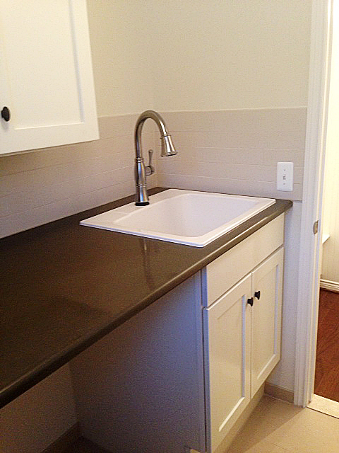 Laundry room with quartz counter top