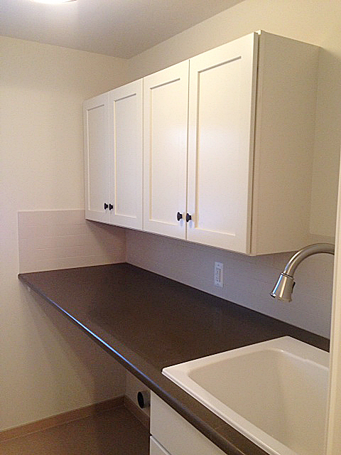 Laundry room with shaker cabinets