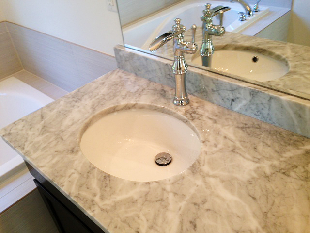 Marble counter top with under mount sink and waterfall faucet