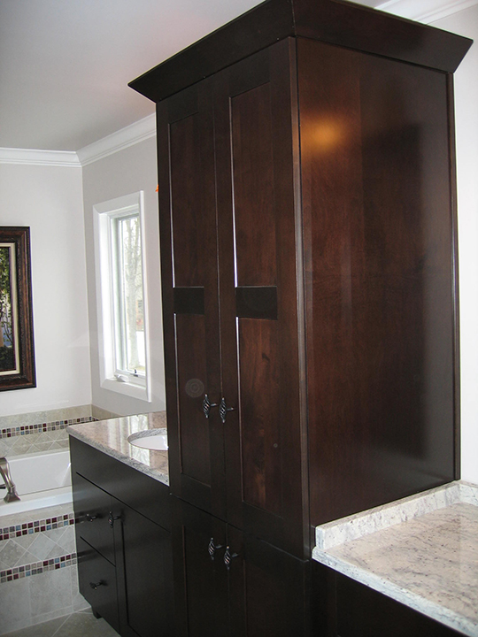 Master bath with tower unit separating his and hers sinks