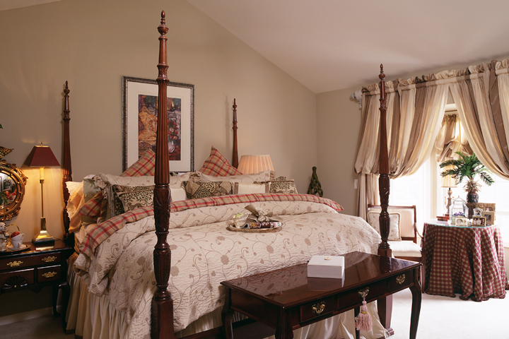 Master bedroom with bay window and vaulted ceiling