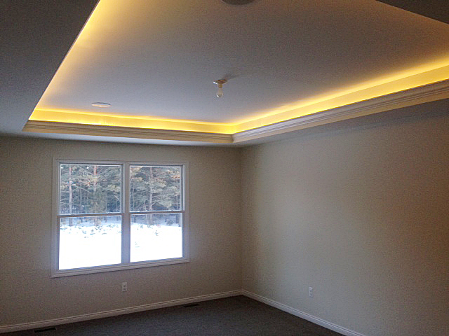Master Bedroom with indirect ceiling lighting