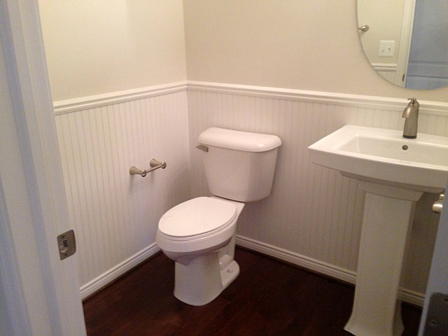Pedestal sink with chair rail and bead board paneling