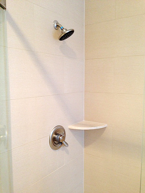 Shower featuring brick stacked tile
