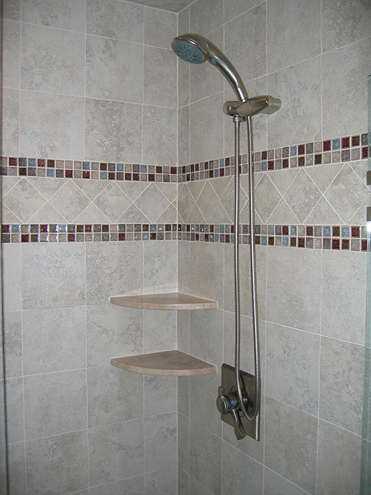 Shower with tile border and marble shelves