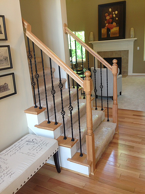 Staircase featuring rod iron basket spindles in diamond pattern