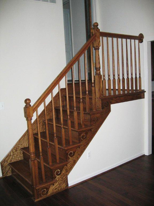 Stairway with maple railing