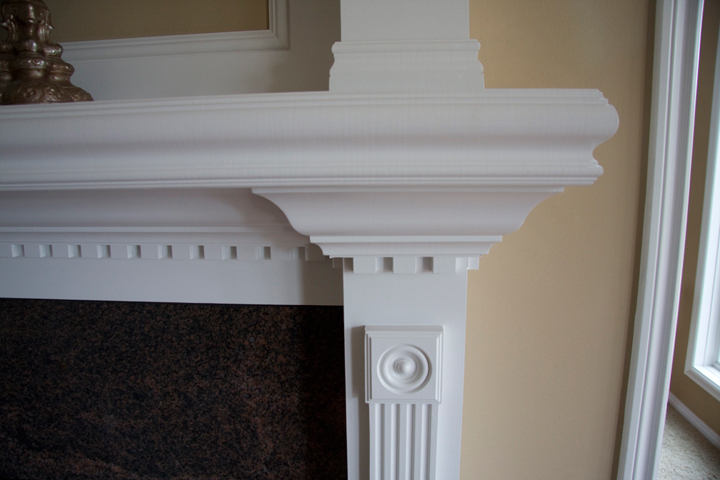 White painted mantel with decorative molding