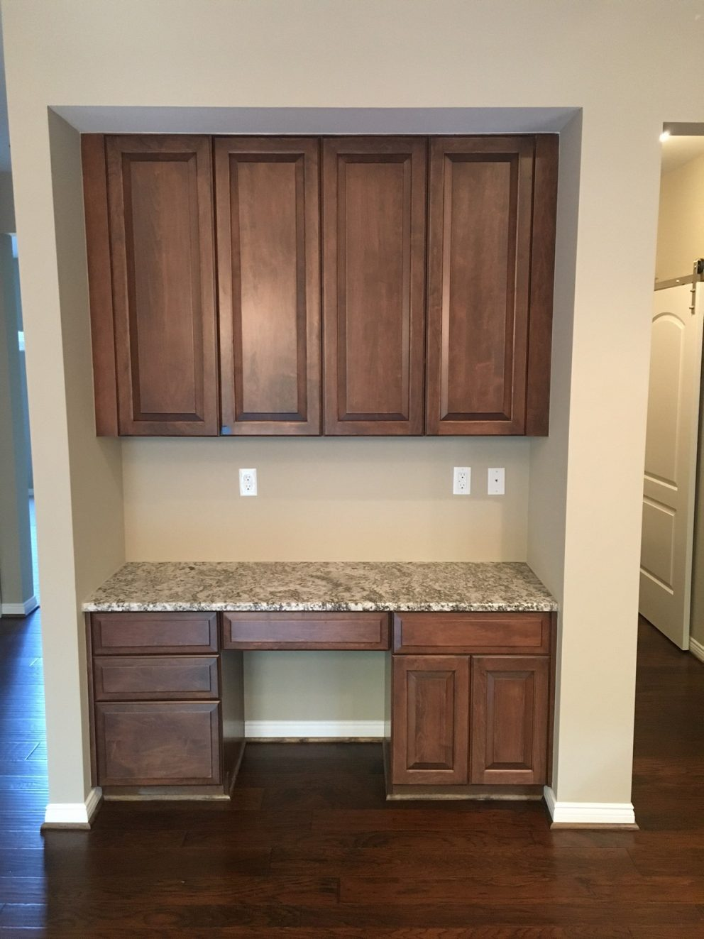 Desk area with additional kitchen cabinetry