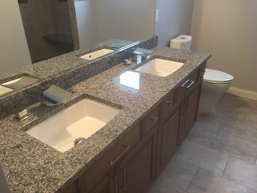 Double sinks featuring stainless steel waterfall faucets