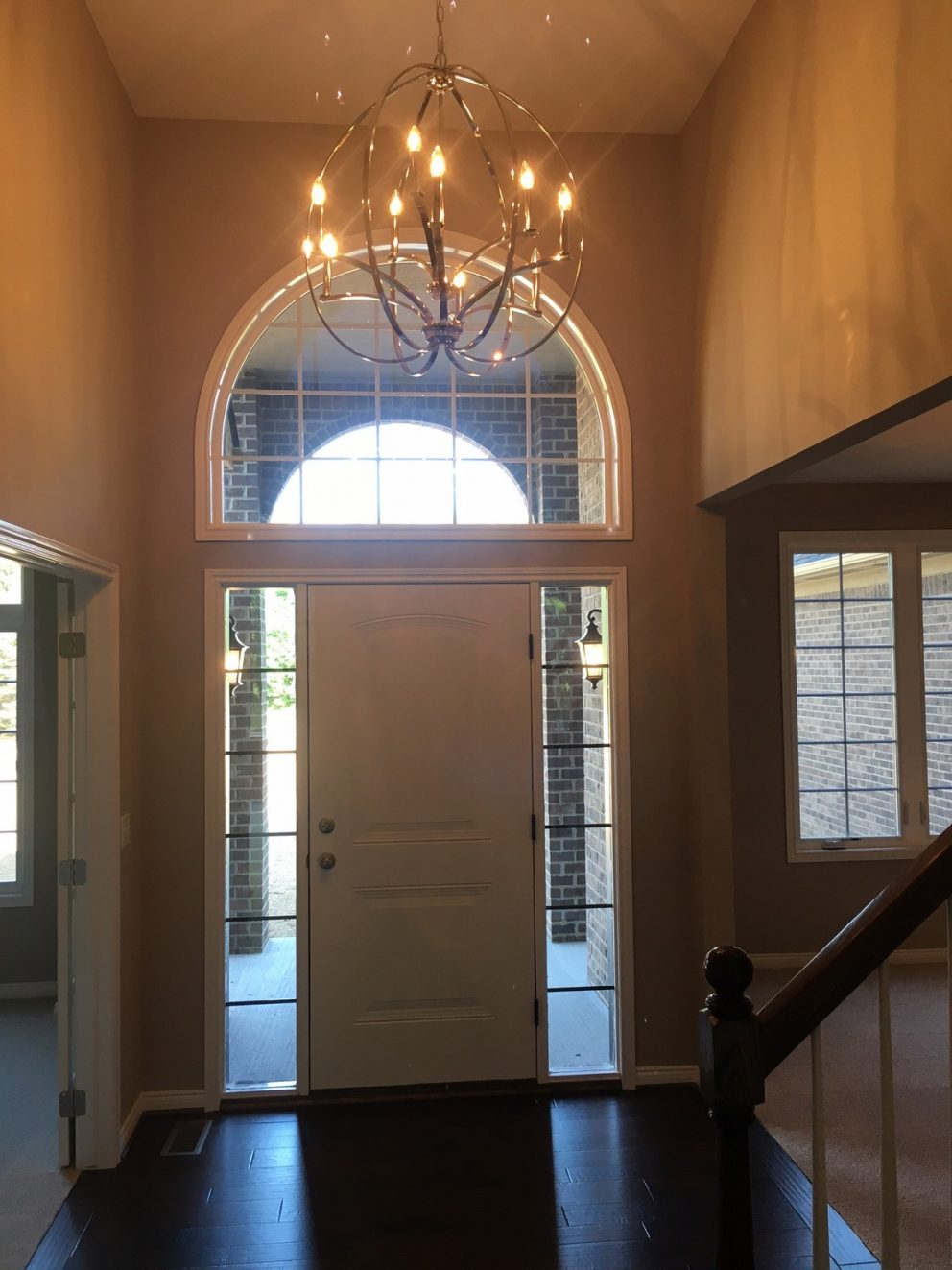 Foyer with high ceilings and chandelier