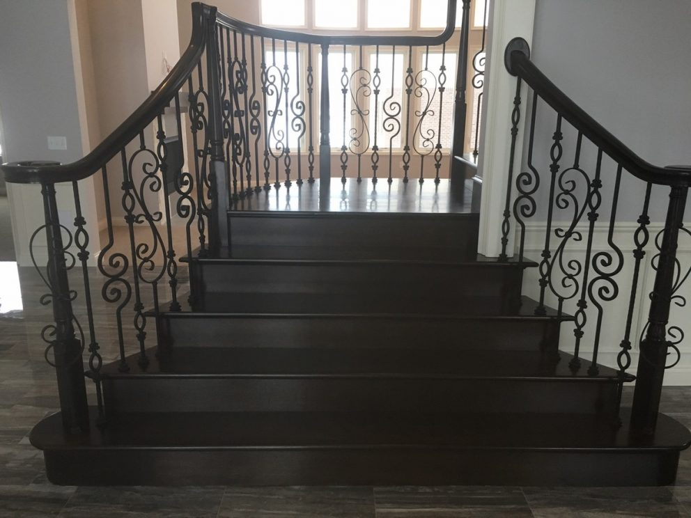 Full wood staircase with decorative rod iron spindles