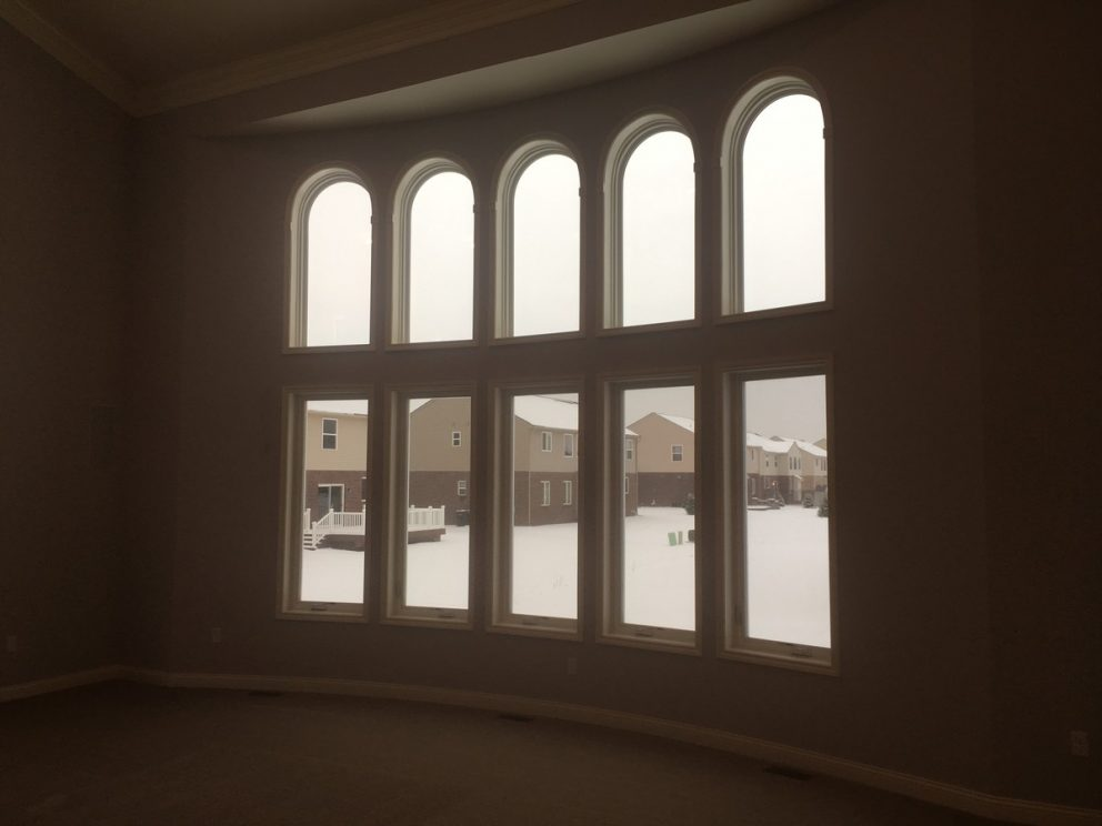 Great room windows on a bowed wall