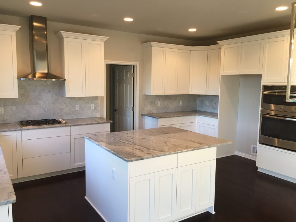 Kitchen with white painted cabinets and shaker doors