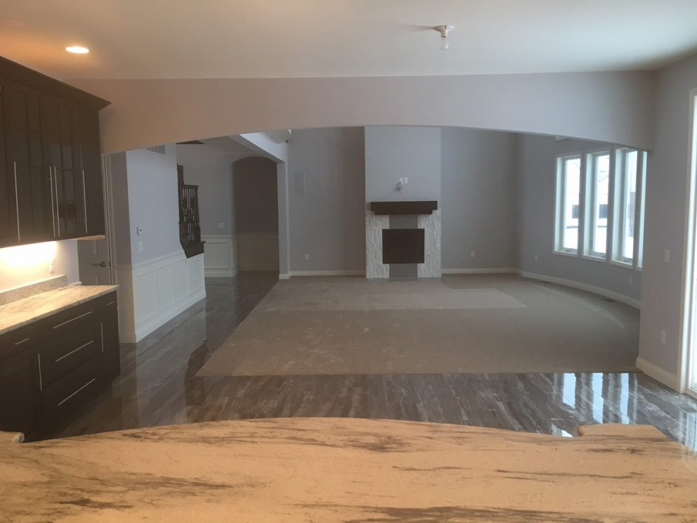 Overlooking the great room from the marble counter top kitchen island