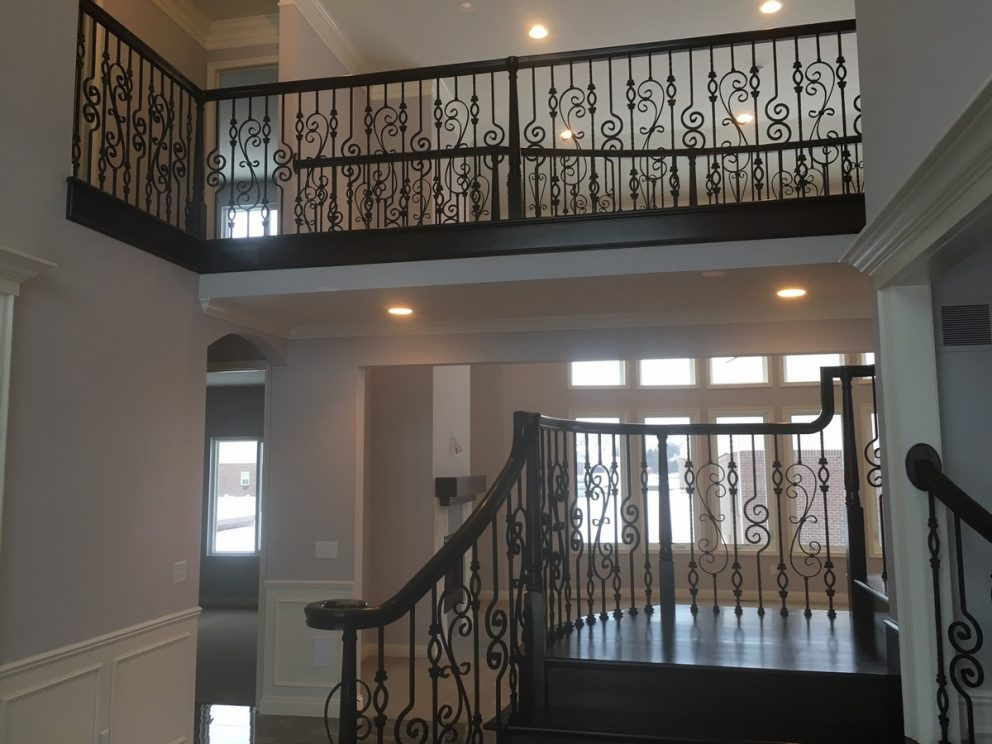 Staircase and balcony with decorative rod iron spindles