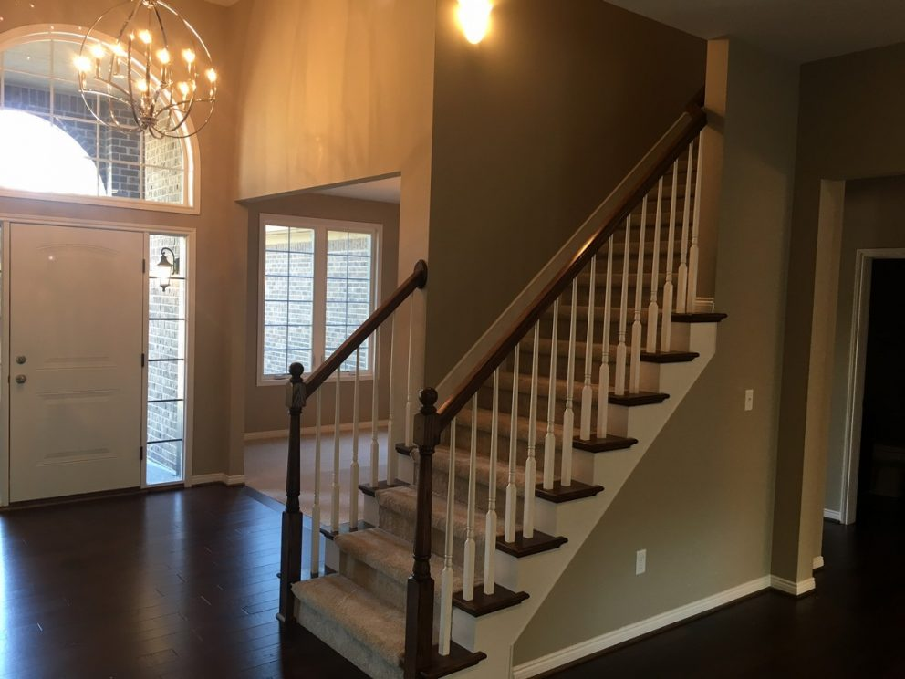 Staircase with stained railings, painted spindles and oak endcaps
