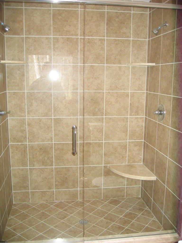 Tiled shower with glass door and dual shower heads
